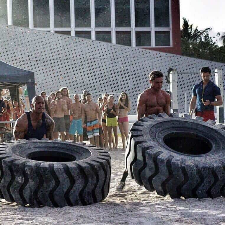 tire flipping with the rock